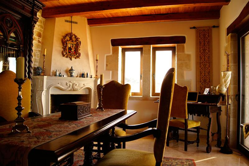 Living and dining room with fireplace - Extremely luxury Venetian-style villa in Chania - Vamos - rentals