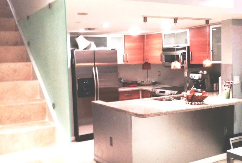 kitchen and stairs lead to bedrooms - SOBE Dluxe NEW corner duplex pkg 3 blocks to ocean - Miami Beach - rentals