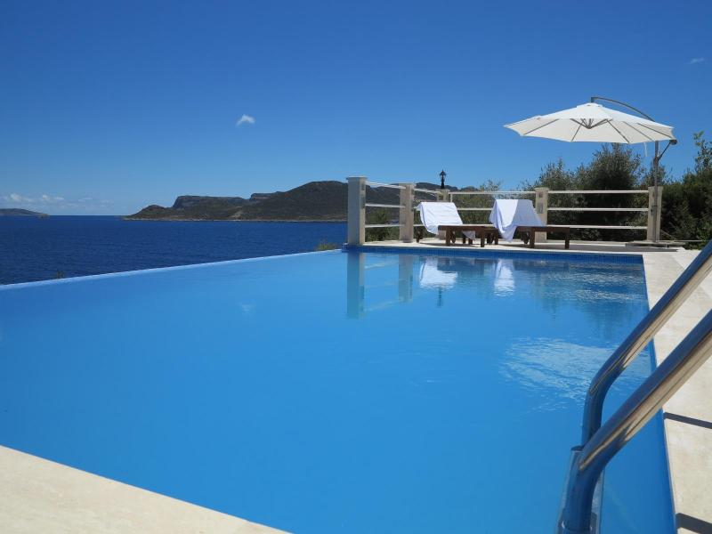 The blue edge of the pool melts into the turquoise sea - Lifestyle villa, private pool, access to sea - Kas - rentals