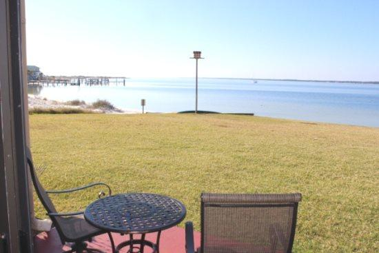 Your view from the Patio - Sunset Harbor Palms Studio 1-102 - Navarre Beach - rentals