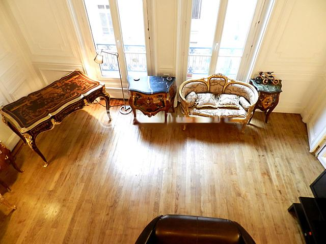19th century ceiling hight: view from mezzanine over the Loft living room - Renovated Studio at the Heart of Triangle d'Or - Île Amsterdam - rentals