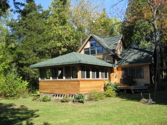 The picture perfect cottage on Lake Champlain. This 1 Bedroom 2 Bath craftsman style cottage is tucked in the corner of a private family estate. - Image 1 - South Hero - rentals