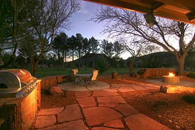 Patio at night with firepit. - Golf Course Home - Sedona - rentals