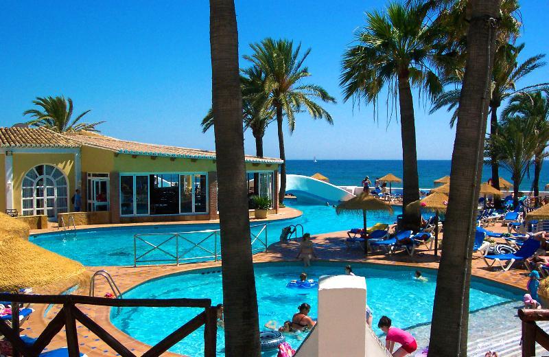 One of the Dona Lola Swimming pools + Pool Restaurant - Beachfront Townhouse near Marbella Spain! - Sitio de Calahonda - rentals