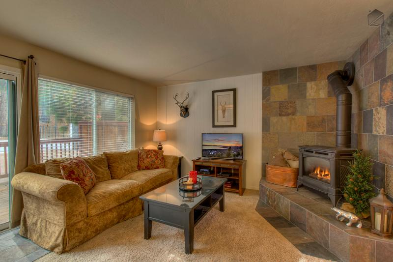 The living room opens to the front deck and has a gas fireplace and flatscreen TV. - Remodeled condo steps from Heavenly skiing - Stairway to Heavenly - South Lake Tahoe - rentals