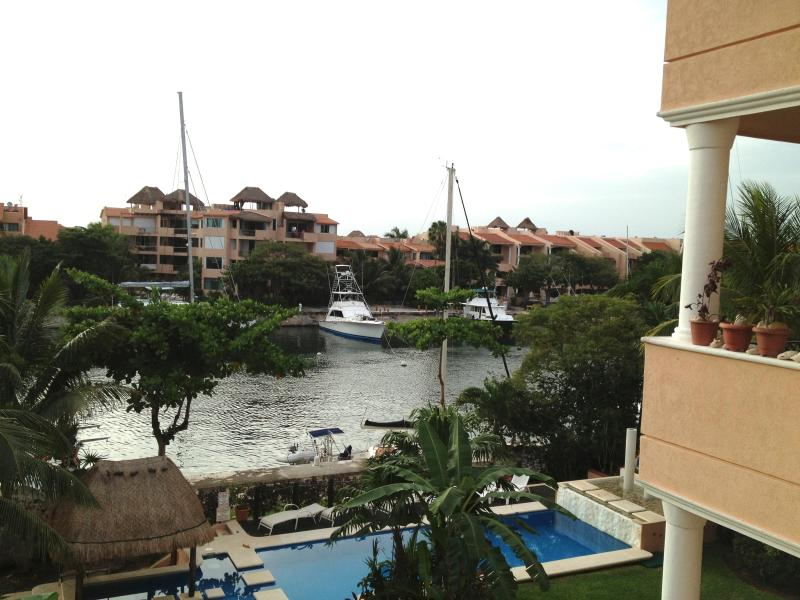 View of the canal from our terrace - The view, sunsets, golfing and So much more! - Puerto Aventuras - rentals
