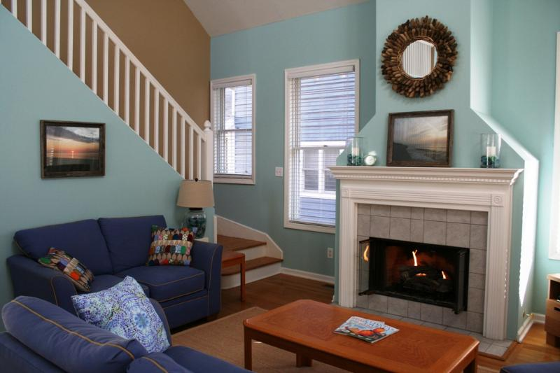 Enjoy a relaxing evening with the whole family by the fire in this newly updated living room. - Steps to Lake, 3/2 sleeps 10 - Michigan City - rentals