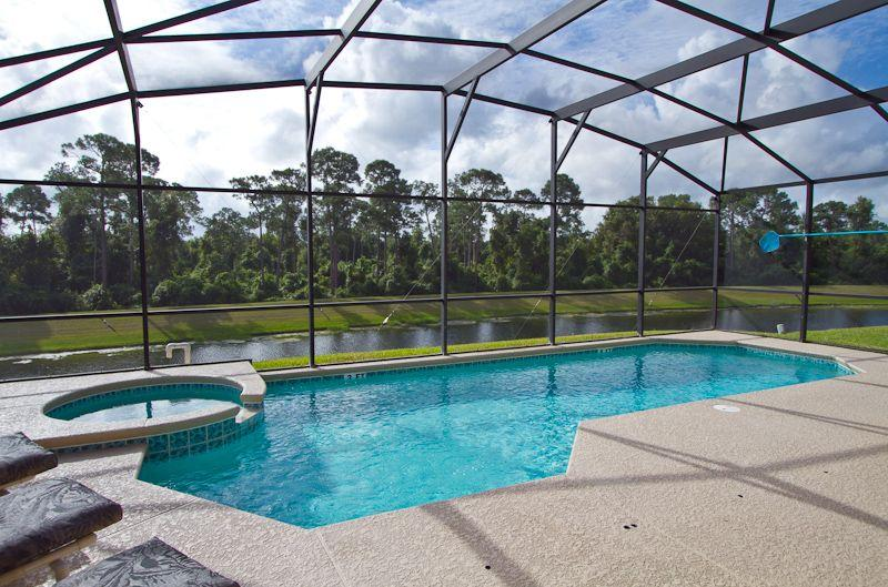 Large pool deck with lake and woodland conservation area views - Golden Palms, luxury of the highest quality - Kissimmee - rentals