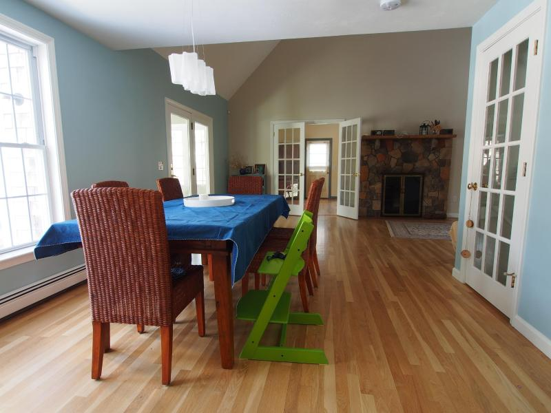View from the kitchen into DR and LR - Waterfront sanctuary with modern amenities - Brewster - rentals
