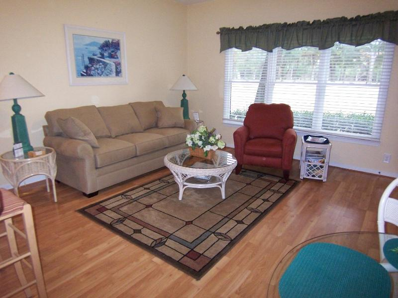 Living room with comfortable sofa and recliner - 2 BR, 2 BA (3CL2) 1st Floor, Golf Sunset Beach, NC - Sunset Beach - rentals