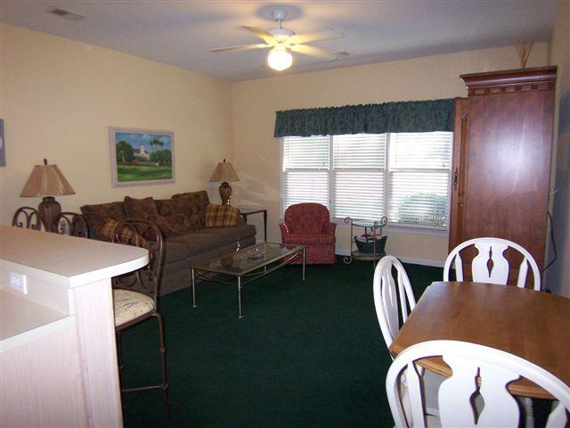 Dining table that seats four - 1BR 1BA (4CL) 1st Floor, Sea Trail Sunset Beach NC - Sunset Beach - rentals