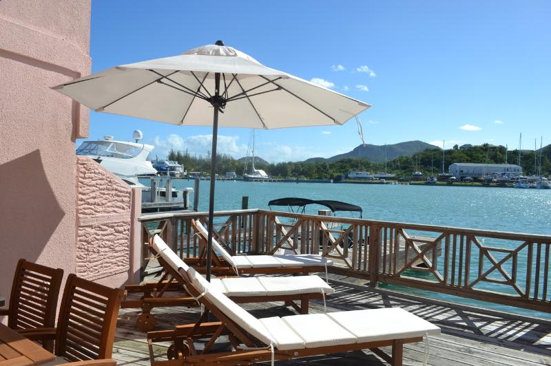 Sun loungers and view - The Boat House - 221D South Finger - sleeps 5 - Jolly Harbour - rentals