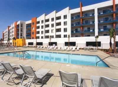 Pool with resort in background - Oceanside Paradise - Oceanside - rentals