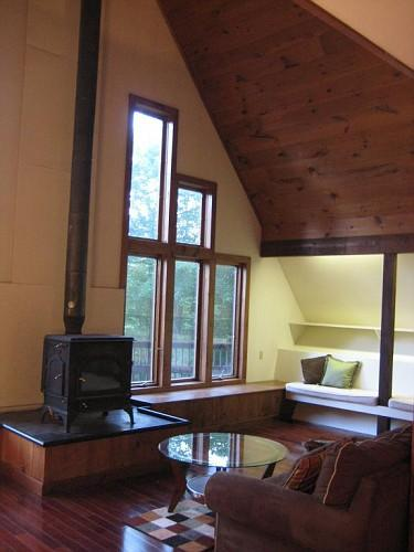 Two-story great room with Vermont Castings woodstove and built-in seating area. - Private, Views, 2800+ sq ft, new 7 person hot tub! - East Dorset - rentals