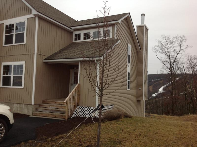 Front exterior with view of slopes background - Brand new luxury home with spectacular views - Tannersville - rentals