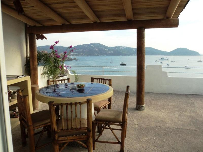outdoor dinning - A Room with a View PH ocean front dinning terrace - Zihuatanejo - rentals