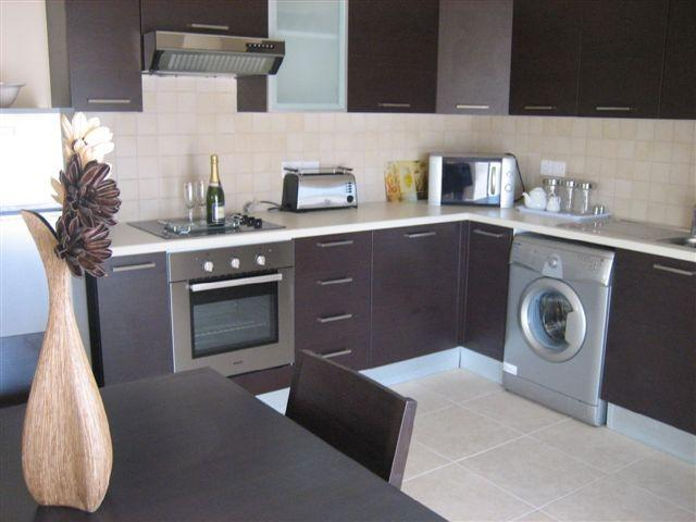 Kitchen and dining area - Penthouse With Large Rooftop Terrace/Pool/Sea View - Tersefanou - rentals