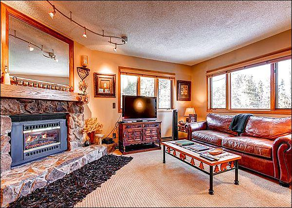 Modern Living Room with a Flat Screen TV and Fireplace - Beautifully Decorated Condo - In the Four Seasons Neighborhood (2050) - Breckenridge - rentals