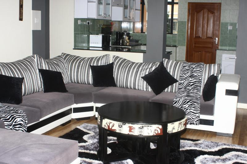 Cozy Living Room opens to a big balcony - Geo Mara Executive Apt Kilimani Plus Rental Car - Nairobi - rentals