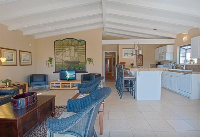 Inside photo showing the living room and kitchen area - 4814 B Neptune- Upper 3 Bedrooms 2 Baths - Newport Beach - rentals