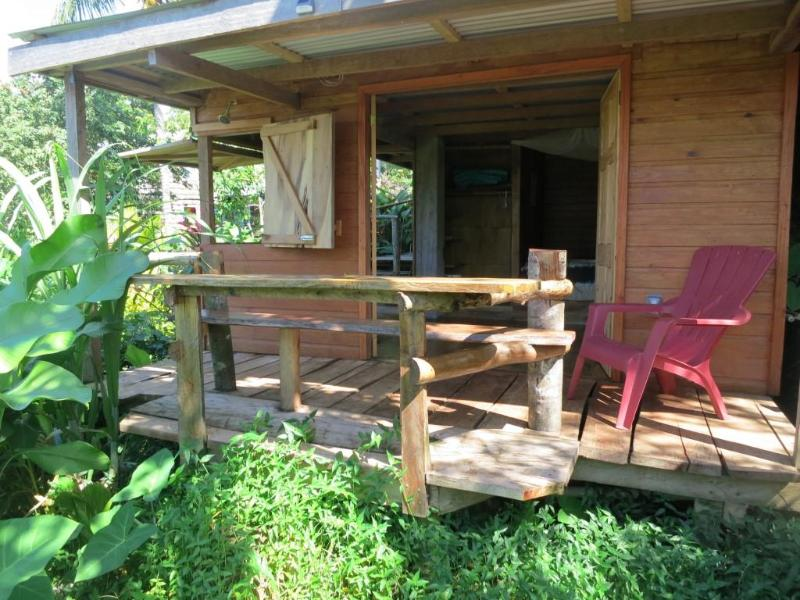 the private patio and dining table veranda - Cozy All Wood Cabin; Ocean/Cabrits Views in Picard - Saint George Parish - rentals