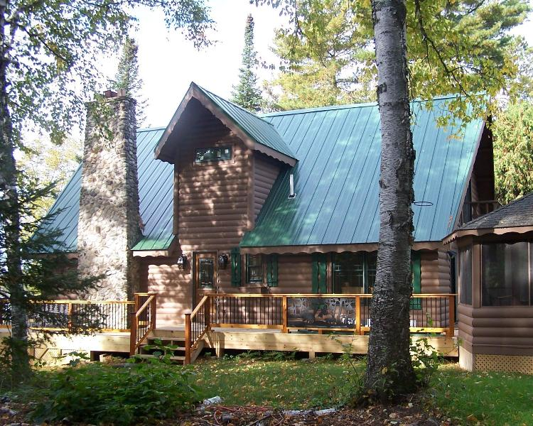 Peaceful setting, side view of our cabin with decking and gazebo - Grove Island Lodge on Lake Vermilion - Tower - rentals