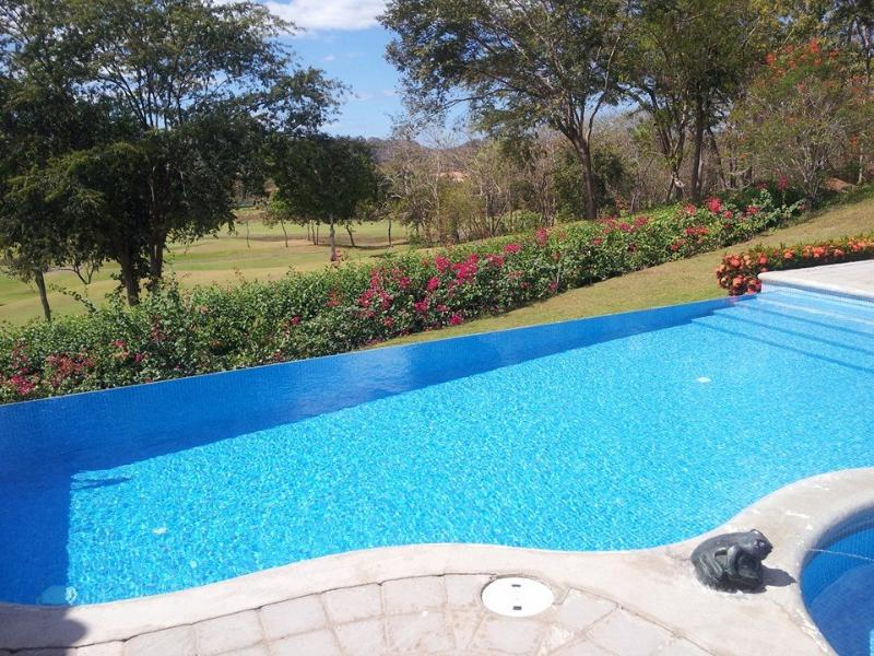Small bouganvillea owners pool (larger pools on resort) - Reserva Conchal Penthouse with stunning views. - Brasilito - rentals