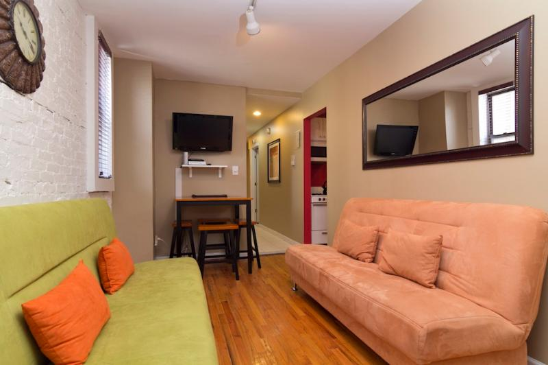 Living Room with Futon sofas - Sleeps 8! 3 Bed/2 Bath Apartment, Times Square, Awesome! (7783) - Manhattan - rentals