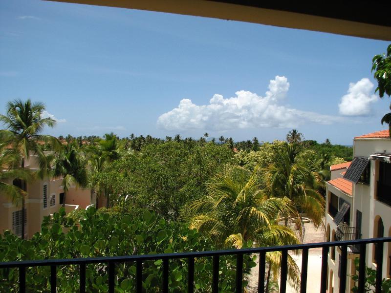 View from the balcony over the tree tops towards the ocean - Executive Palmas Del Mar Resort villa near the Beach - Humacao - rentals