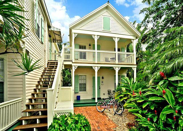Front of house with beautiful landscaping - Palm Gardens - Great for Big Groups! 4 Condos 4 Hot Tubs 1 Pool. Sleeps 16! - Key West - rentals