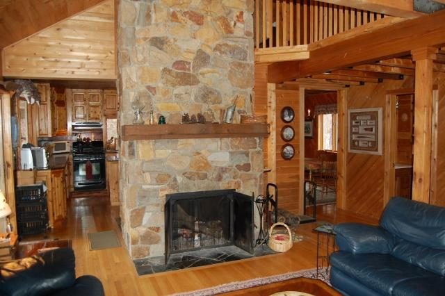 Floor to ceiling fieldstone fireplace in living room - AMAZING VIEWS OF MOOSEHEAD LAKE AND SUNSETS - Greenville - rentals