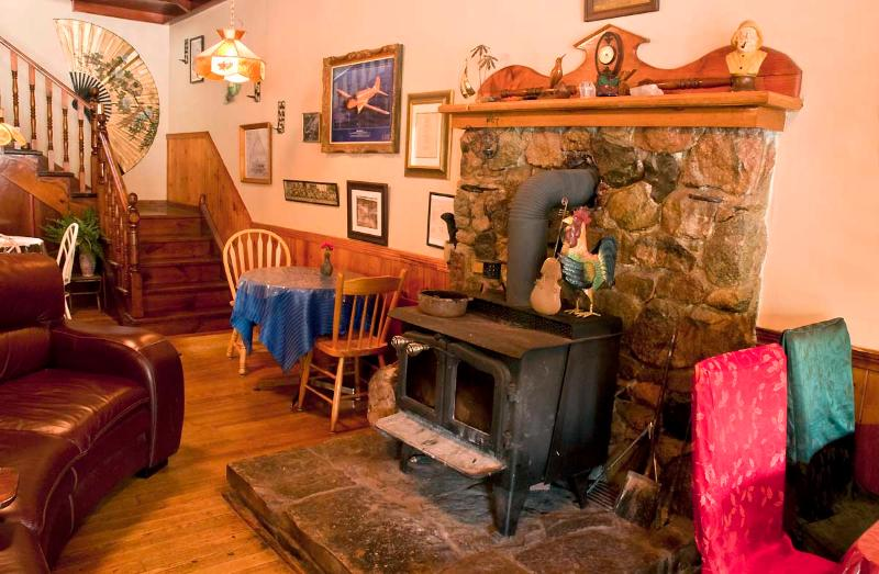Wood stove in the lounge at the Guest House - Port Albert Inn in a tiny village near the sandy beach on Ontario's West Coast! - Port Albert - rentals