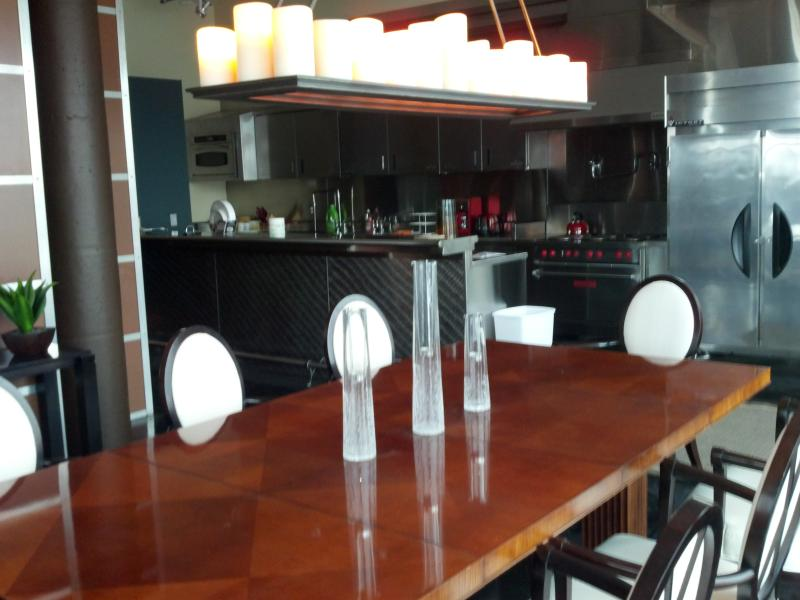 Dining Room with Stainless Kitchen in Background - Penthouse Condo on Market Street in NuLu - Louisville - rentals