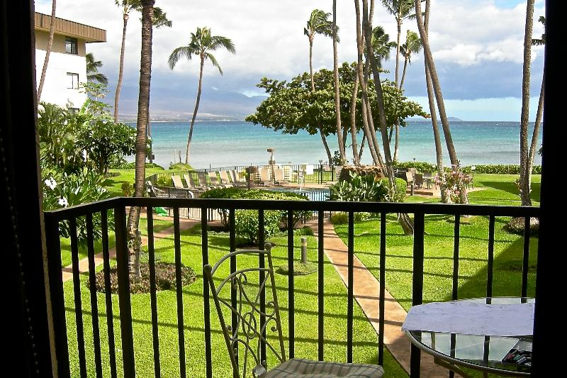 View of courtyard,  Haleakala volcano, and ocean from condo lanai. - 2BD Beachfront in Maui Paradise - Wailuku - rentals