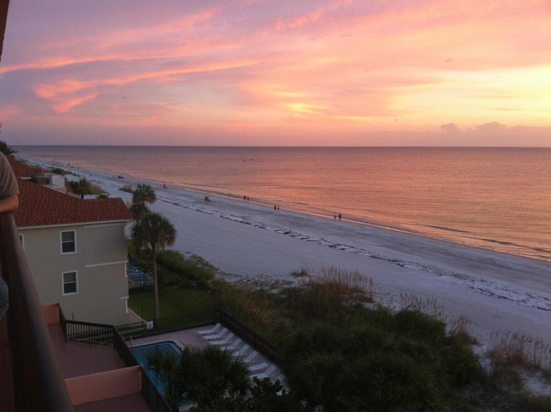 Sunset and heated pool view from balcony. - Rose Beachfront Florida Condo - Indian Shores - rentals
