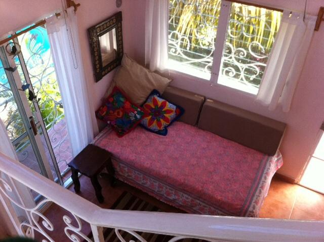 Looking down from upstairs loft - Apartment/Suite in our private home - Izamal - rentals