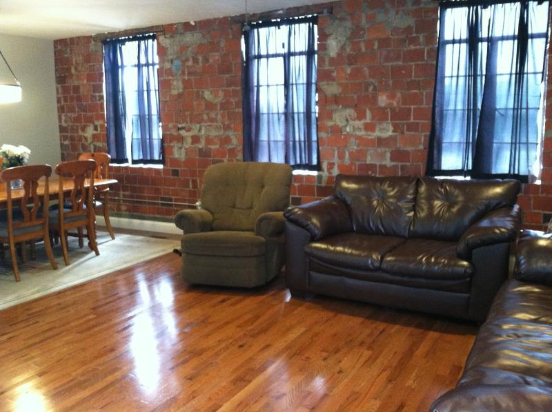 """Living area and kitchen table, original brick wall from 1913 with original windows. - Shenandoah Valley, """"The Building"""" circa 1913 - Virginia - rentals"""