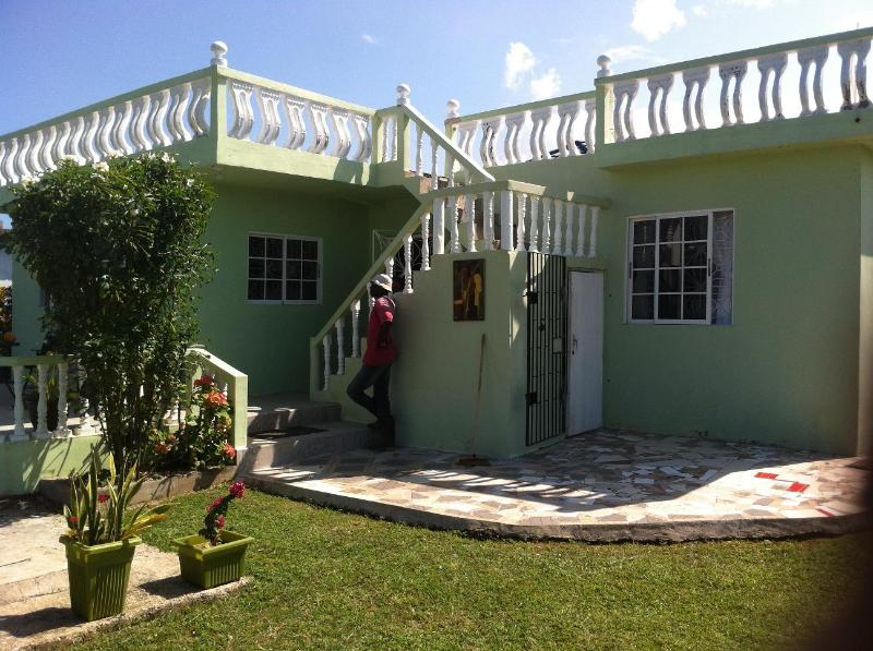 exterior view back porch and grounds - Three beautiful sisters by the sea! - Duncans - rentals