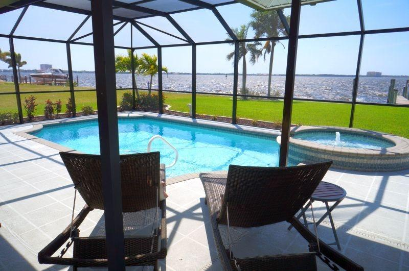 Edith Esplanade - Cape Coral 3b/2ba Deluxe Home, River Front, w/Electric Heated Pool/Spa, HSW Internet, Boat Dock with Lift - Image 1 - Cape Coral - rentals