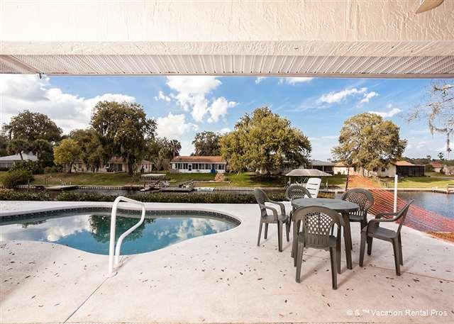 A huge pool deck great for backyard BBQs - Palm Paradise House with Pool and HDTV - Palm Coast - rentals
