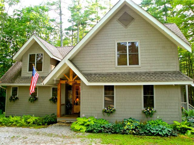Escape to this wonderful artisan style mountain home to enjoy the cool breezes at a higher elevation in Lake Toxaway Estates - Image 1 - Lake Toxaway - rentals