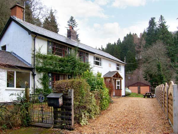 FORESTRY COTTAGE, riverside location with woodland views, woodburner, walks and - Image 1 - Llanfor - rentals