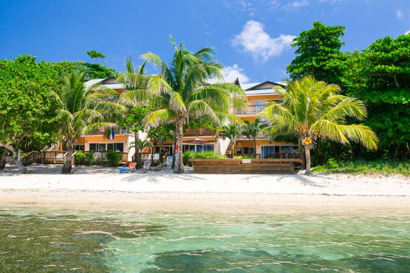 From the water...unit is bottom right - West Bay Beachfront Treasure ! - Roatan - rentals