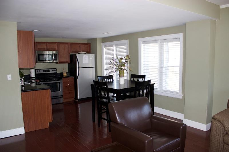 View of the kitchen from the living room. - Plaza Living in Kansas City - Kansas City - rentals