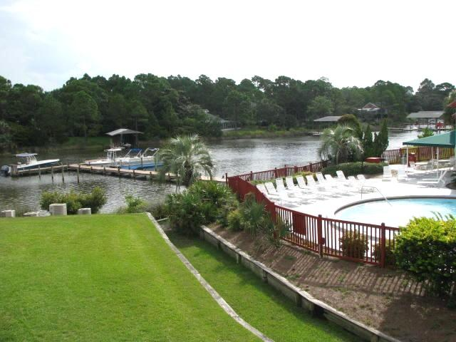 Pool area and Grand Lagoon - Lagoon Villa with dock and pier - Panama City Beach - rentals