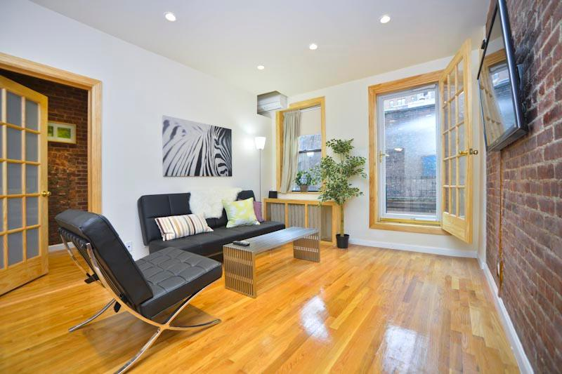 Living room with door to private terrace, contemporary furnishings, hardwood floors - *DYLAN* 1 Bedroom with Spacious Private Terrace - New York City - rentals