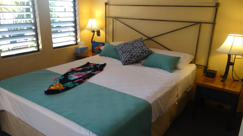 Master bedroom overlooking pool doors to private balcony and separate door to bathroom as ensuite - Port Douglas Fully Self Contained by the beach - Port Douglas - rentals