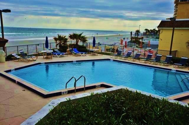 Relax by Outside Heated Pool Overlooking Beach. - Your Model Oceanside Vacationers Dream. - Daytona Beach - rentals