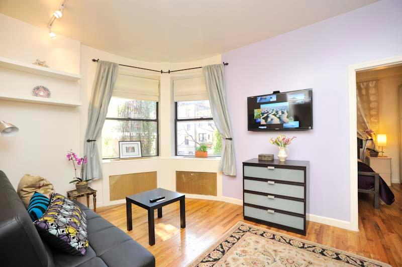 Living Room - Odyssey UWS Town House 1 Bedroom- Sunny & Bright - New York City - rentals