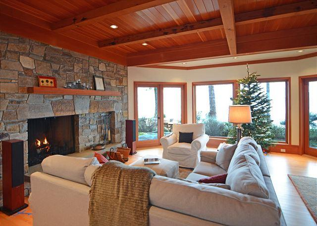 Incredible stone fireplace across the wall of the living room. - Sunsets over the Salish Sea on Orcas Island - Eastsound - rentals